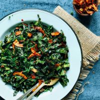 Plate of healthy vegan Collard Greens with Coconut Bacon
