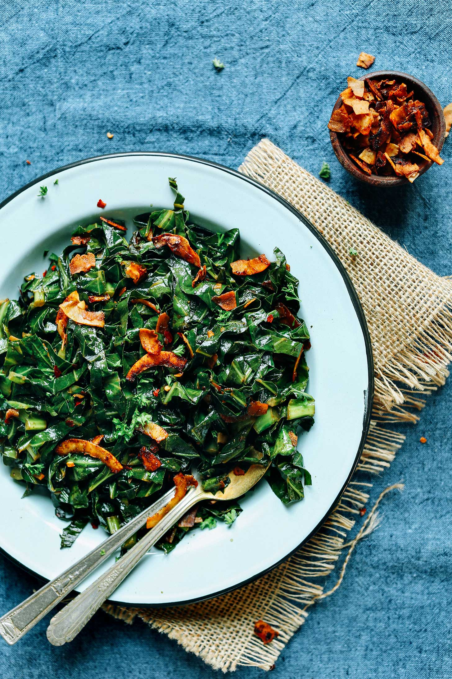 A plate of healthy vegan Collard Greens with Coconut Bacon