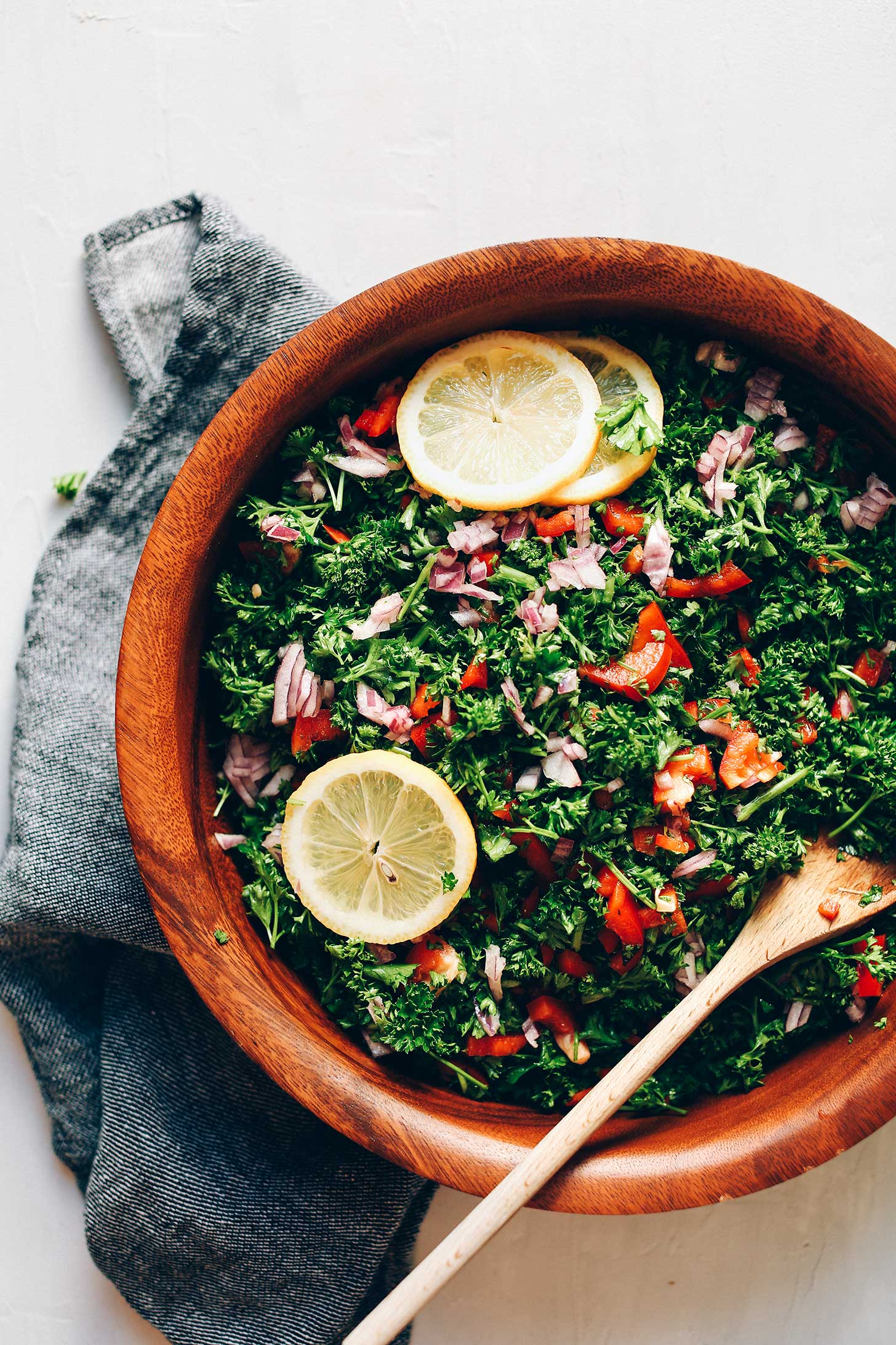 Wood bowl filled with vegan Grain-Free Tabbouleh Salad