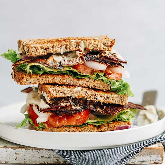 Stacked halves of a Vegan BLT Sandwich on a plate