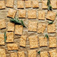 Parchment-lined baking sheet of Vegan GF Rosemary Crackers
