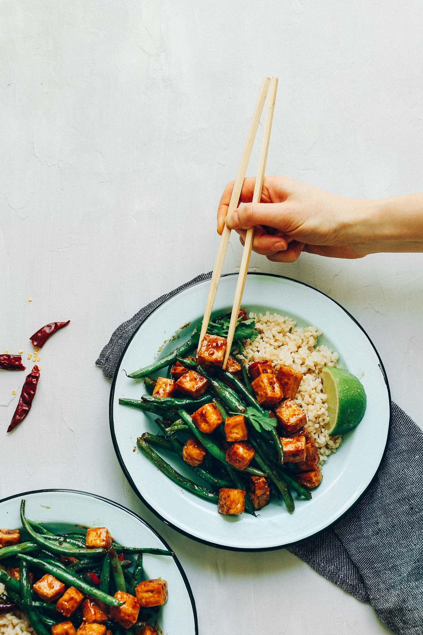 Using chopsticks to grab a bite of delicious and healthy Almond Butter Tofu Stir-Fry