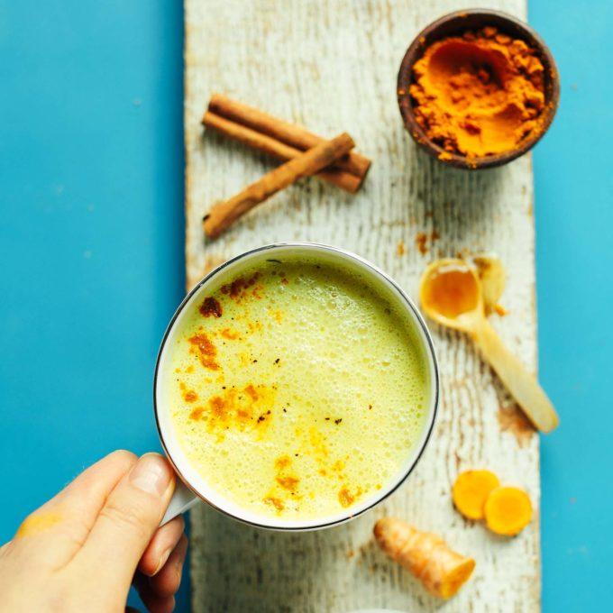 Grabbing a mug of our gluten-free vegan Golden Milk Latte for an anti-inflammatory afternoon treat