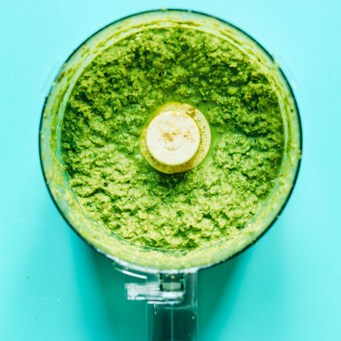 Food processor with ingredients for our gluten-free vegan Green Curry Paste recipe