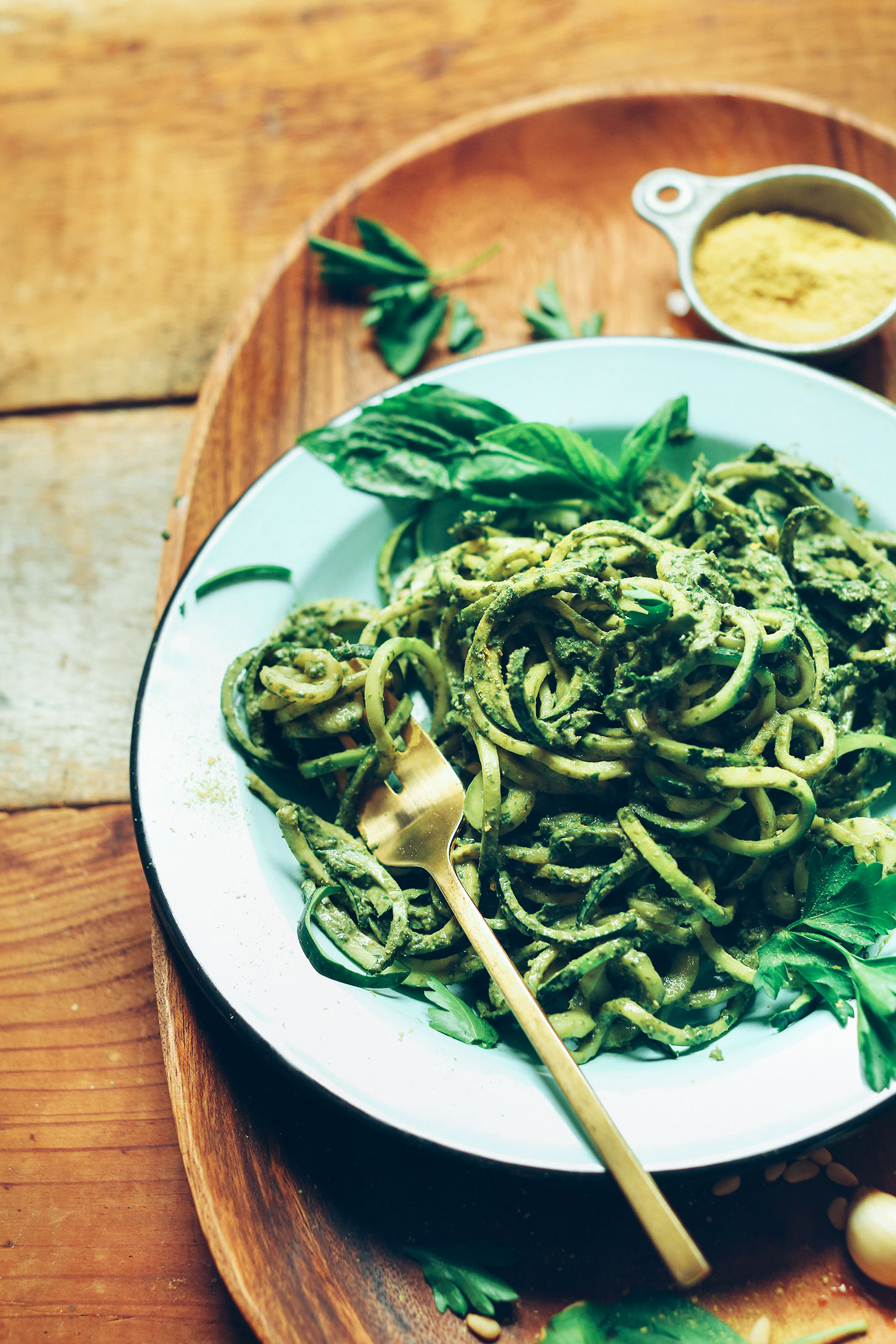 Bowl of spiralized zucchini noodles with Easy Vegan Pesto