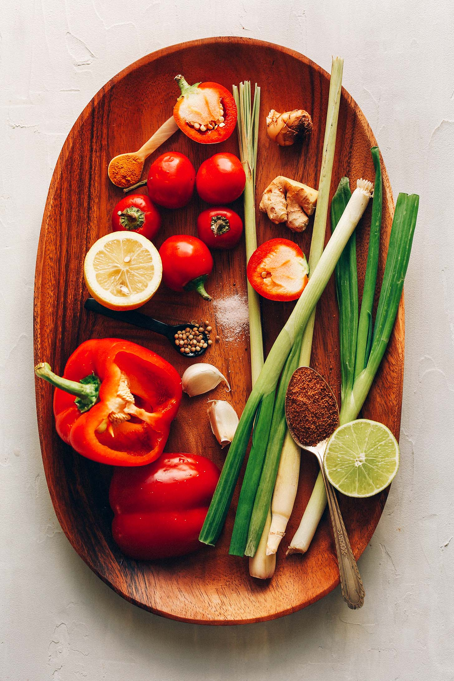 Wood platter with ingredients for making our Easy DIY Red Curry Paste recipe