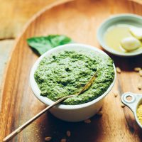 Spoon resting in a bowl of our Easy Vegan Pesto recipe