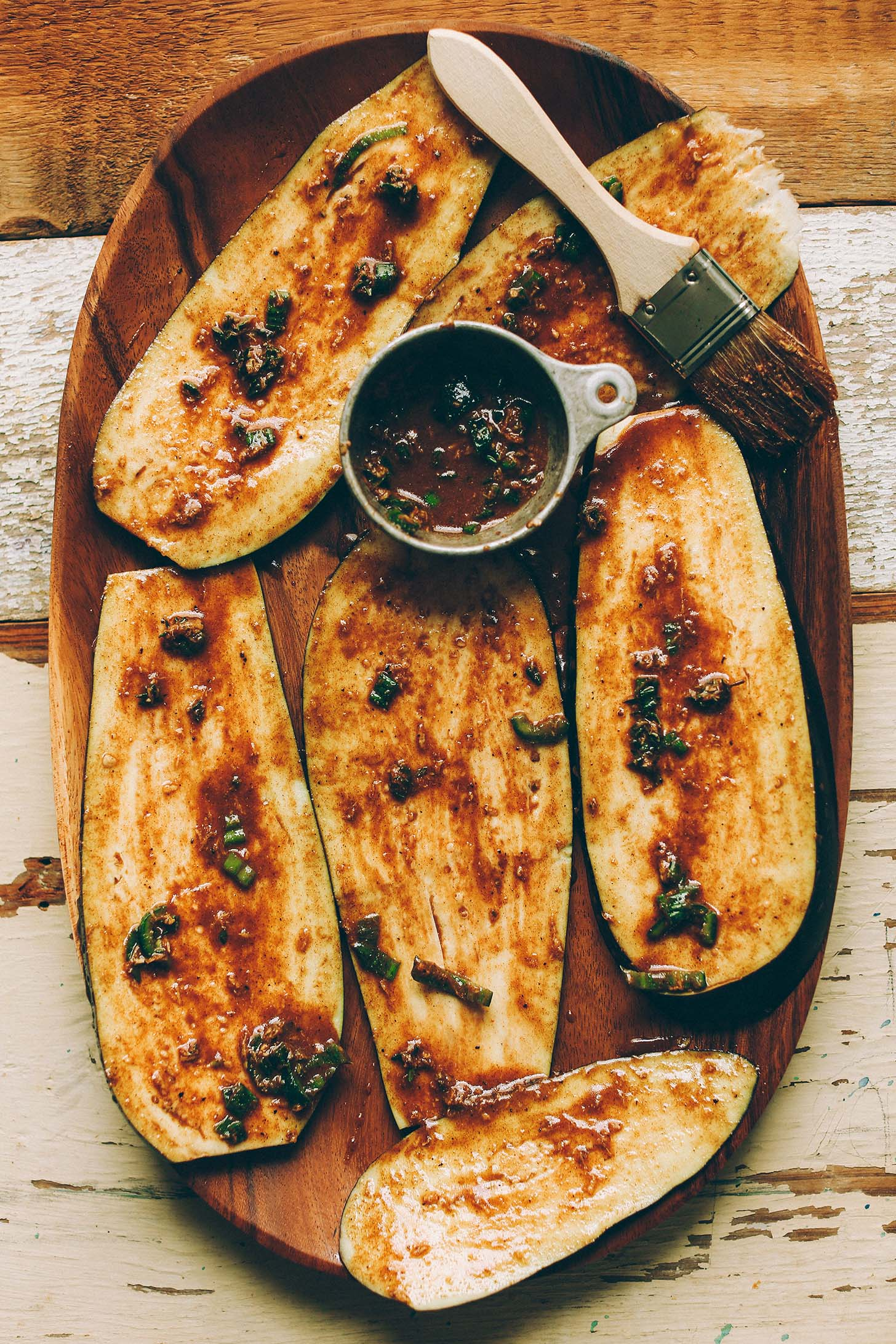 Thinly sliced eggplant slathered with gluten-free homemade Jamaican Jerk dressing
