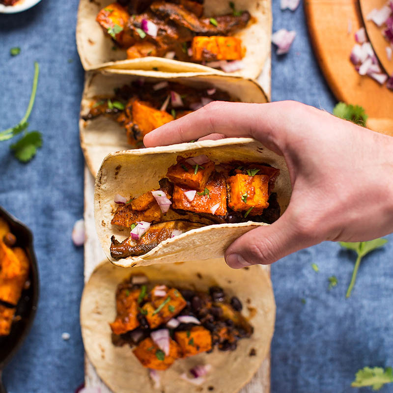 Holding a Saucy Portobello and Butternut Squash Vegan Taco