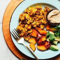 Plate of roasted sweet potato, avocado, baba ganoush, and Vegan Chickpea Scramble