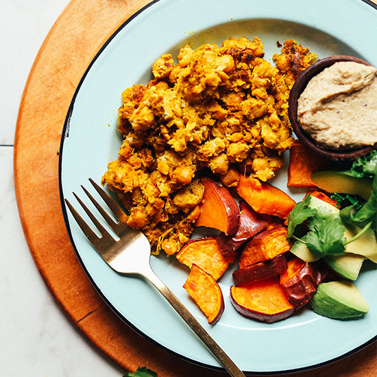 Plate of roasted sweet potato, avocado, baba ganoush, and Vegan Chickpea Scramble