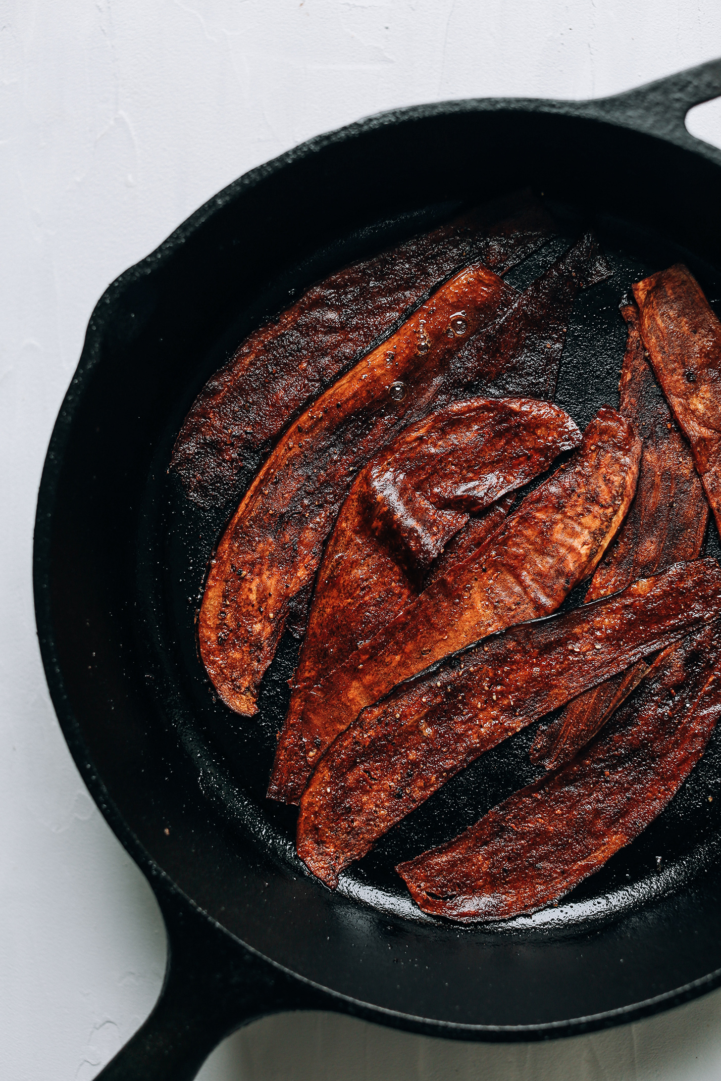 Making eggplant bacon in a cast-iron skillet