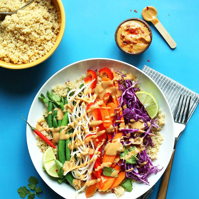 Bowls of quinoa, peanut sauce, and Vegan Gado-Gado
