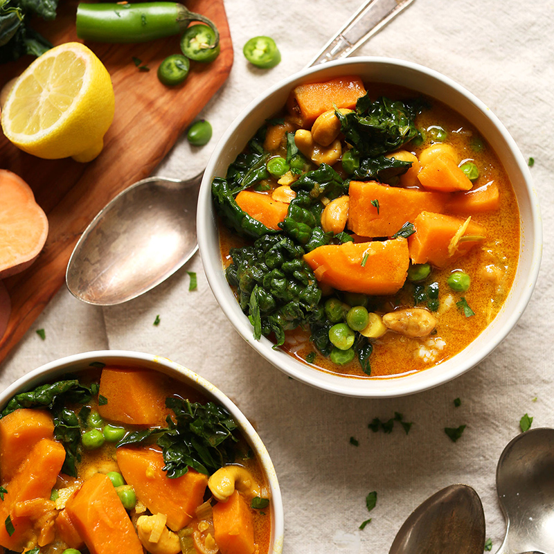 Two bowls of our hearty vegan Sweet Potato Kale Curry Soup