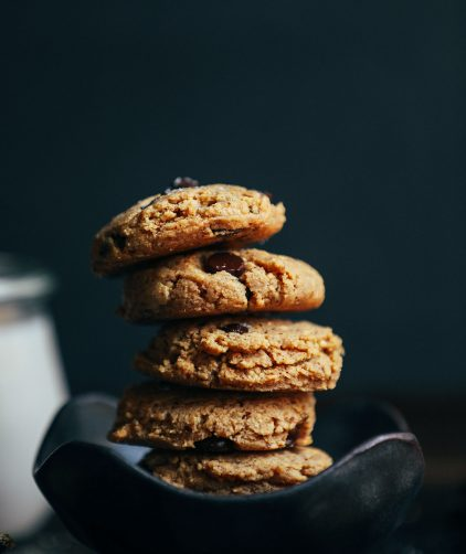 A curvy bowl stacked with vegan gluten-free Almond Butter Chocolate Chip Cookies