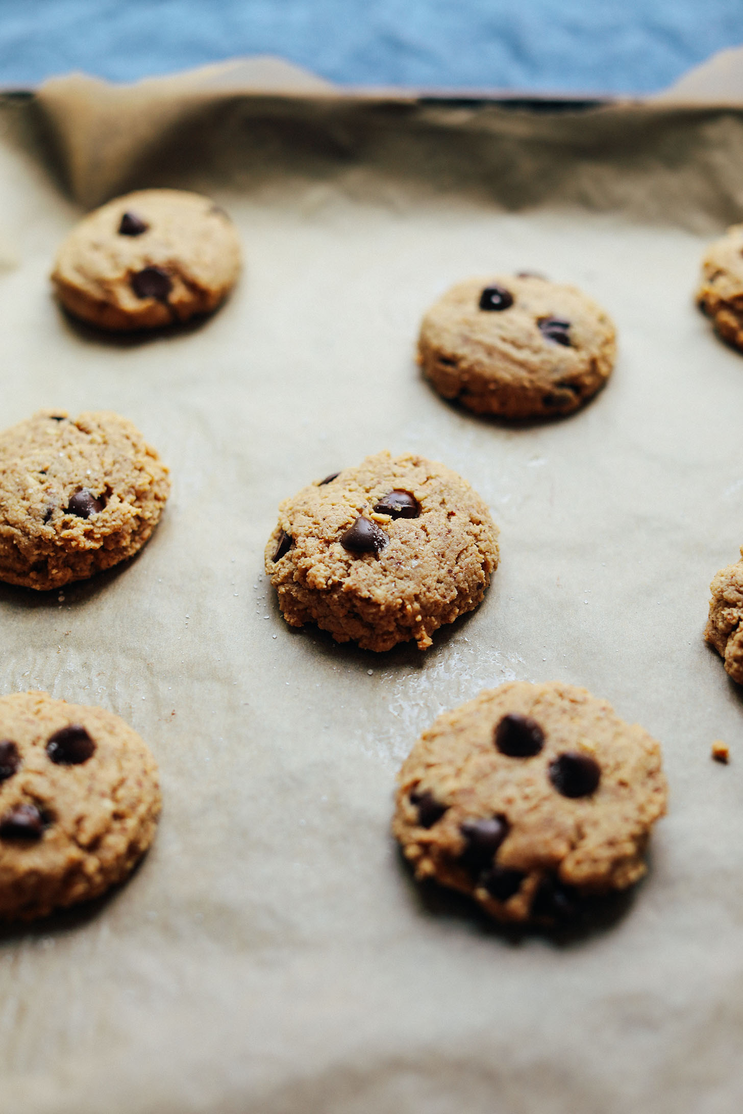 Parchment-lined baking sheet with Grain-Free Almond Butter Chocolate Chip Cookies