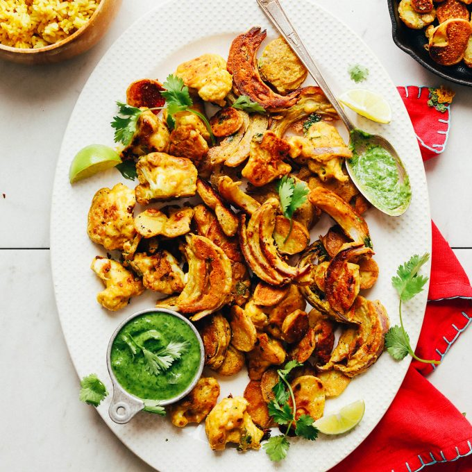 Platter filled with delicious pan-fried Vegetable Pakoras that are gluten-free and vegan