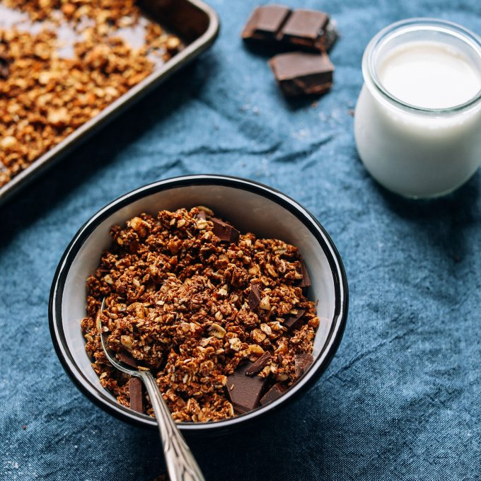 Bowl of Dark Chocolate Sea Salt Granola with dairy-free milk on the side