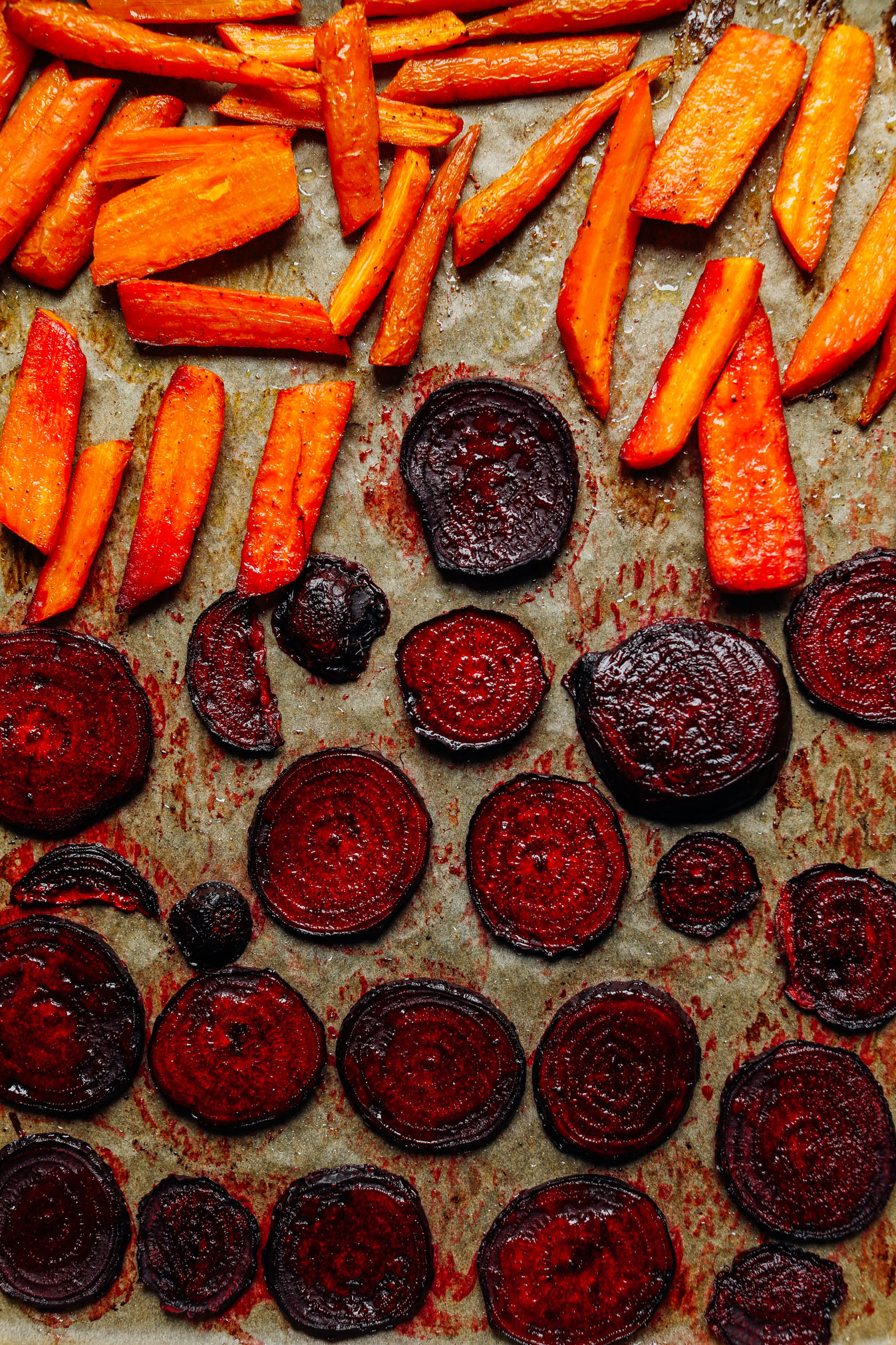 Baking sheet with freshly roasted carrots and beet slices for dipping in our Easy Vegan Crudite recipe