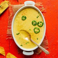 Ceramic baking dish filled with Creamy Roasted Jalapeno Vegan Queso