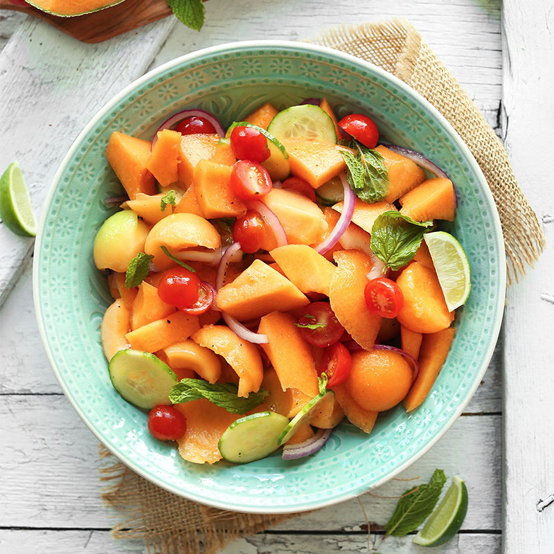 Bowl of our delicious Tomato Cucumber Cantaloupe for a simple summer side