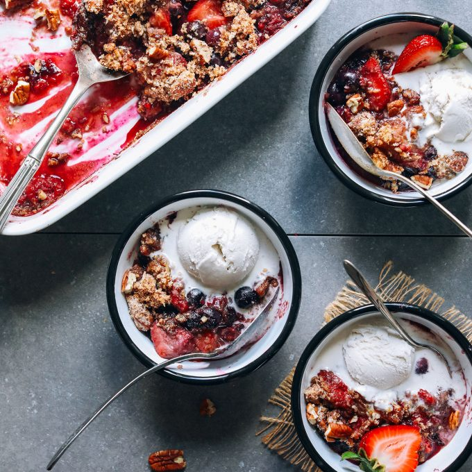 Bowls of Grain-Free Berry Crisp for a delicious plant-based dessert