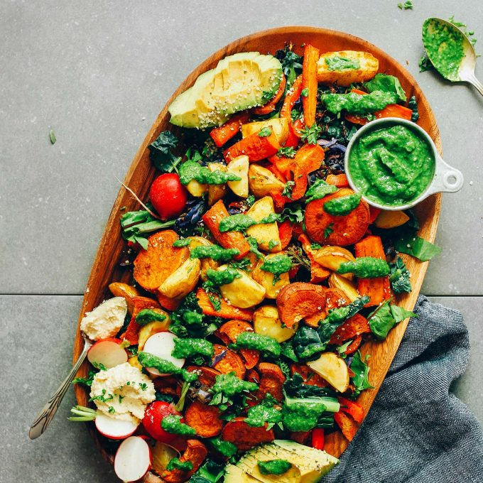 Serving platter filled with Amazing Roasted Vegetable Salad & Chimichurri