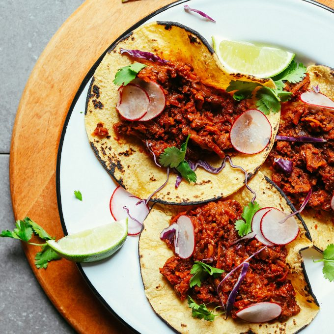 Plate of healthy plant-based tacos made with our Vegan Barbacoa recipe