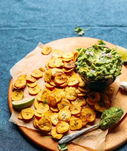 Display of Baked Plantain Chips and Garlicky Guac for a healthy plant-based snack