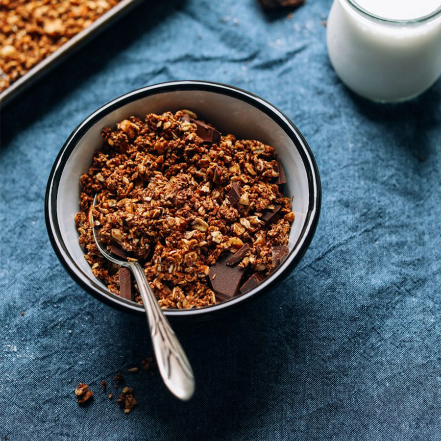 Spoon in a bowl of homemade Dark Chocolate Sea Salt Granola