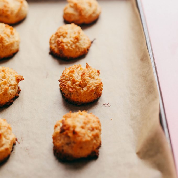 Parchment-lined baking sheet with Vegan Coconut Macaroons