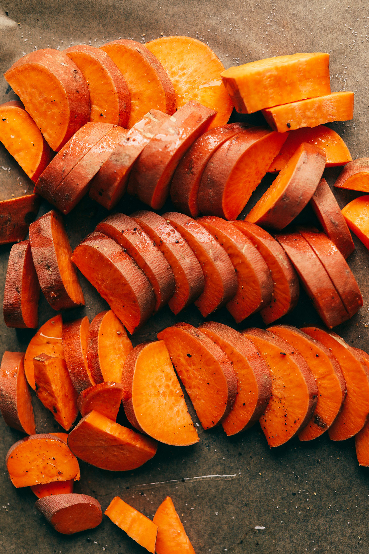 Sliced sweet potato ready for roasting and adding to this green salad
