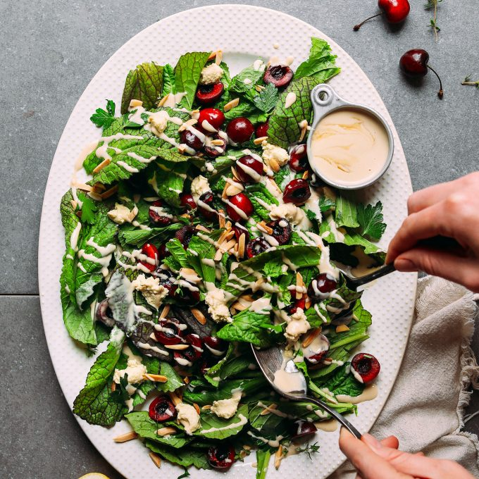 Mustard Green Cherry Salad with Nut Cheese & Tahini Dressing
