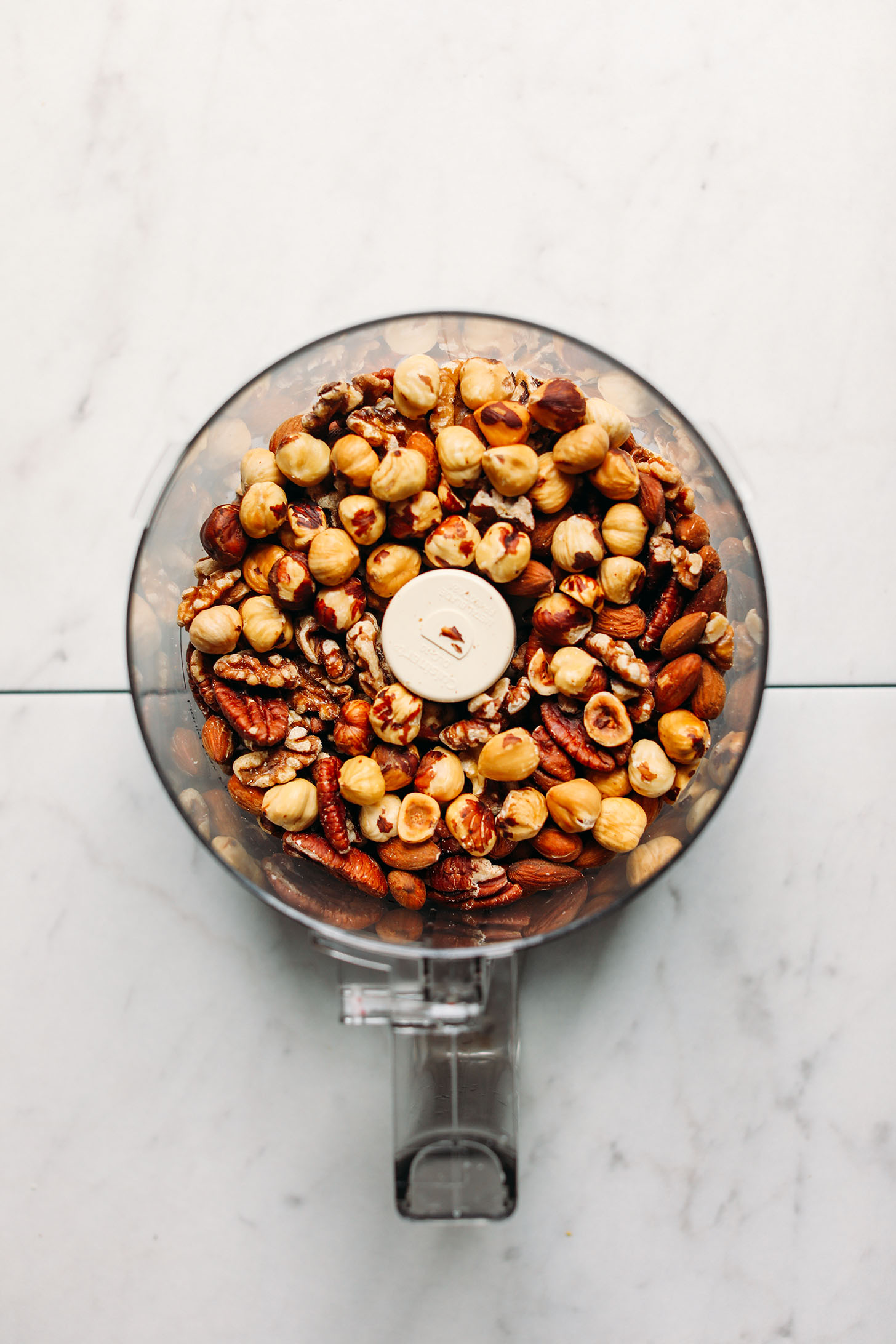Roasted nuts in a food processor for making homemade nut butter