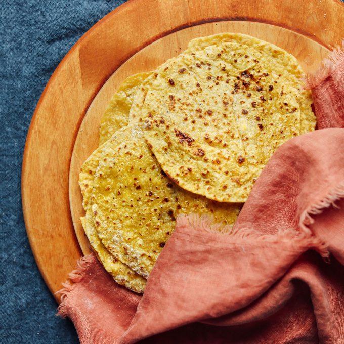 Fresh Plantain Tortillas on a wood cutting board