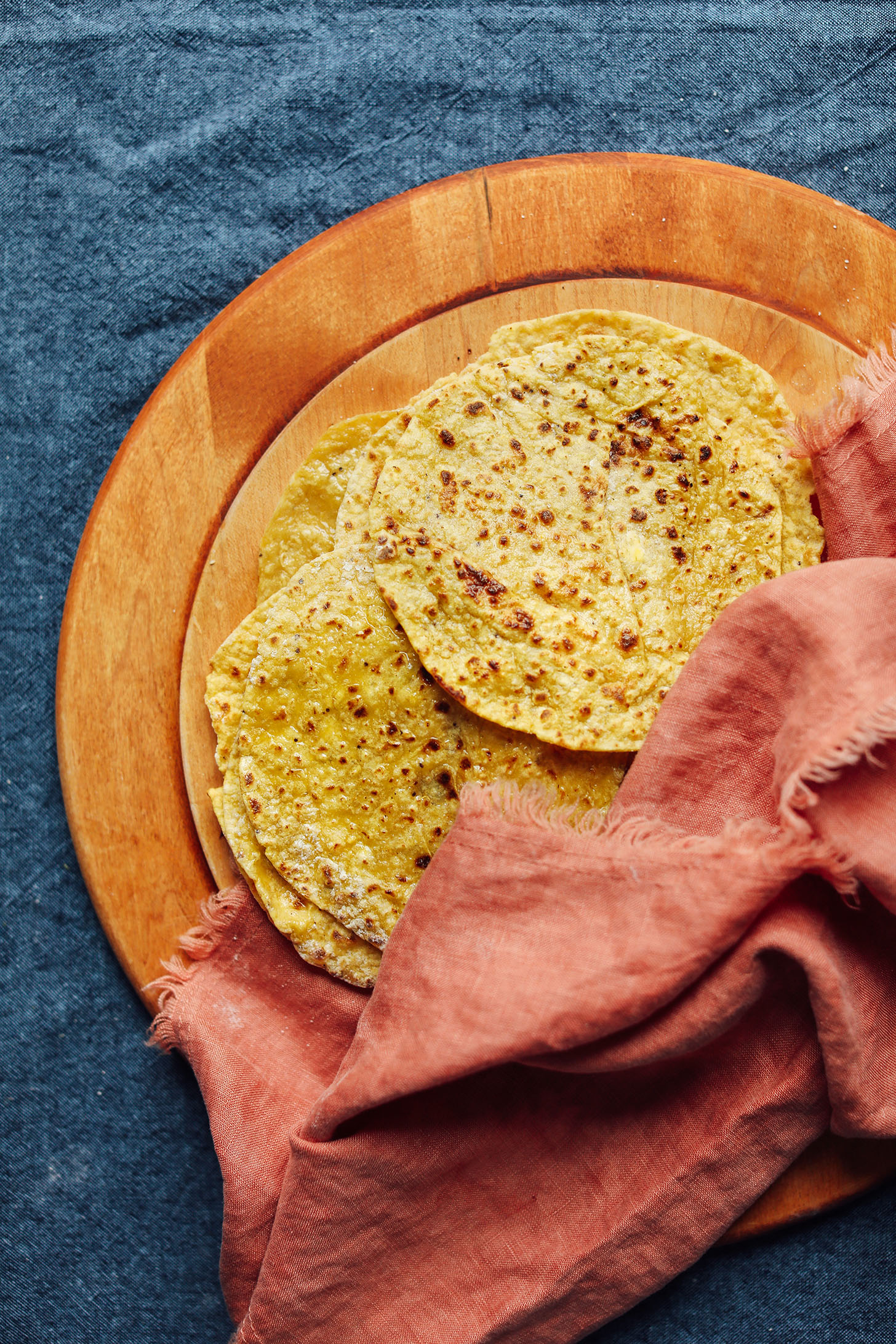 Fresh Plantain Tortillas on a wood cutting board