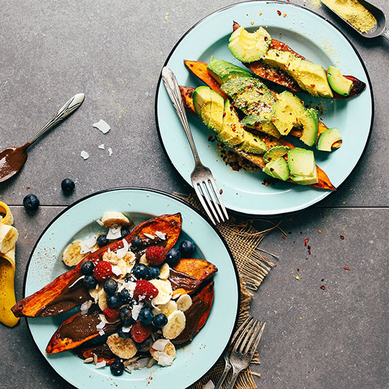 Two plates of Baked Sweet Potatoes with one having savory toppings and the other sweet