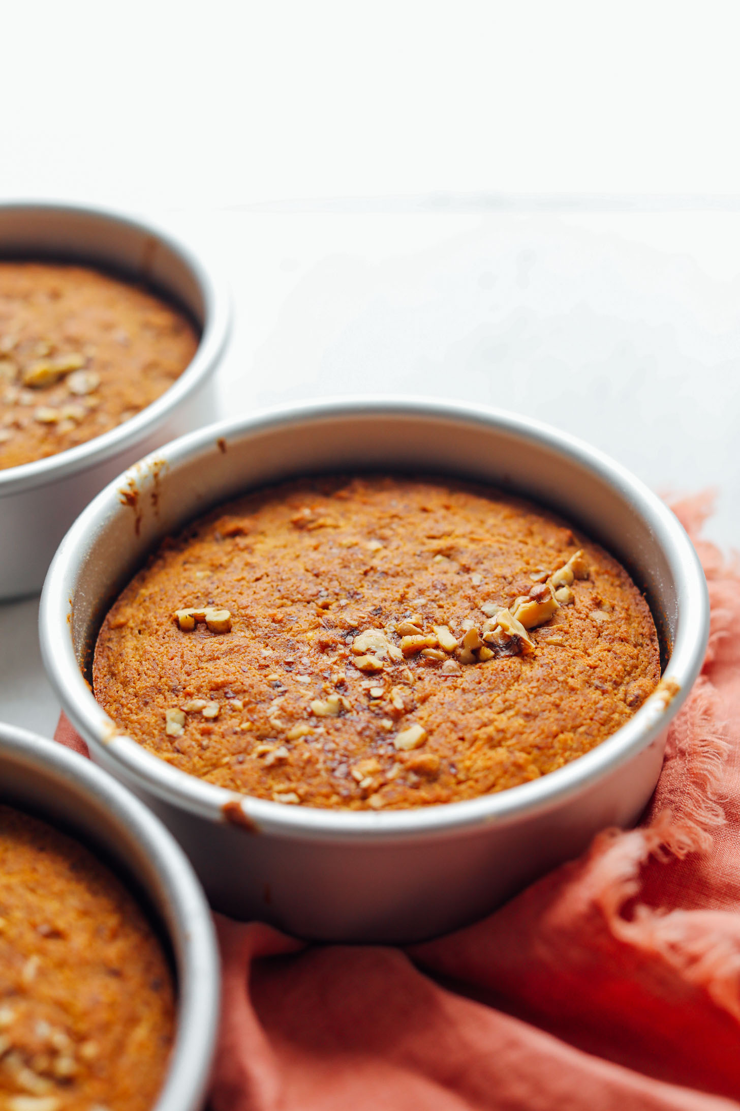 Round baking pans with freshly baked Vegan Gluten-Free Carrot Cake