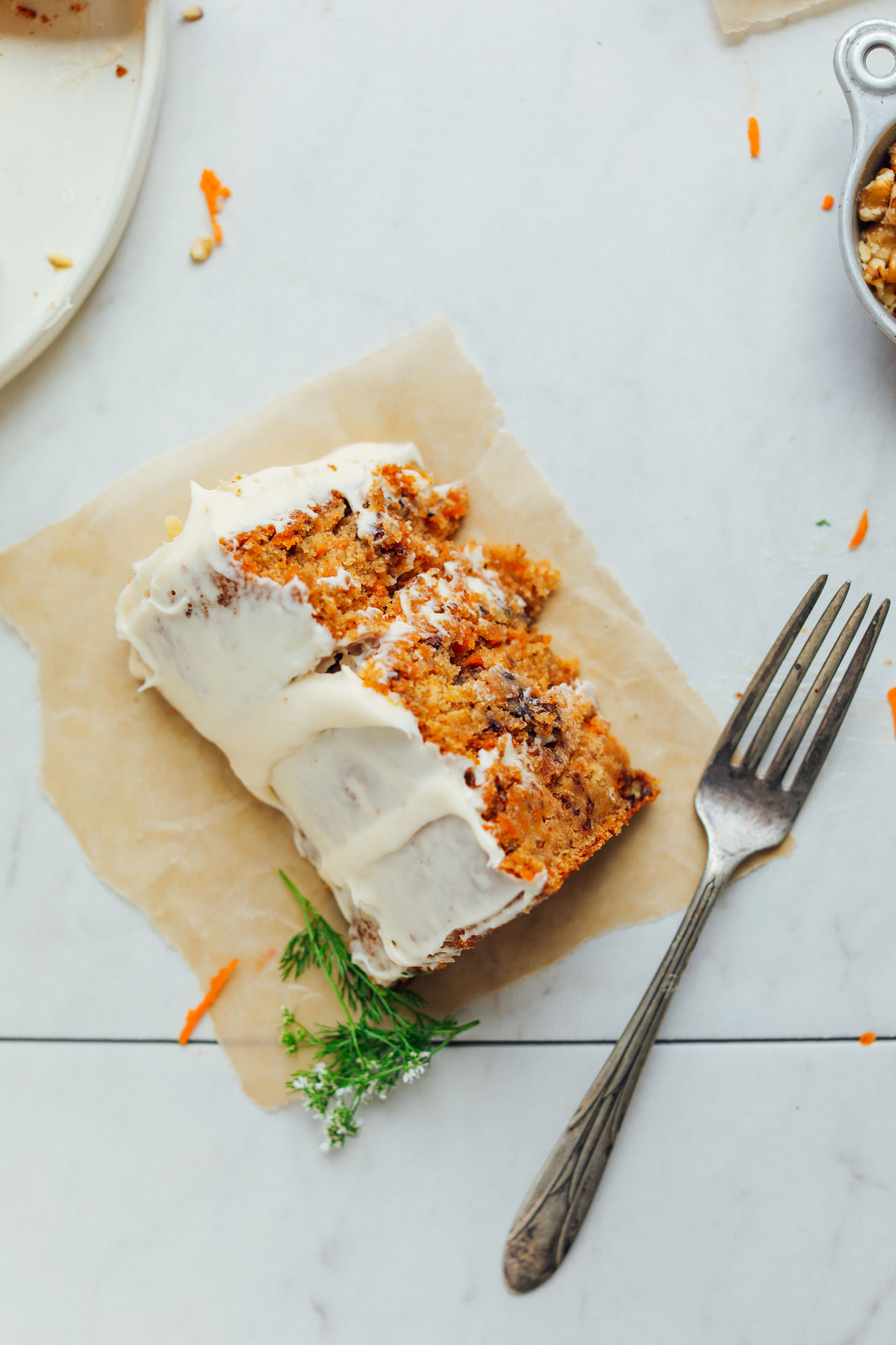 Slice of Vegan Gluten-Free Carrot Cake on a parchment paper square