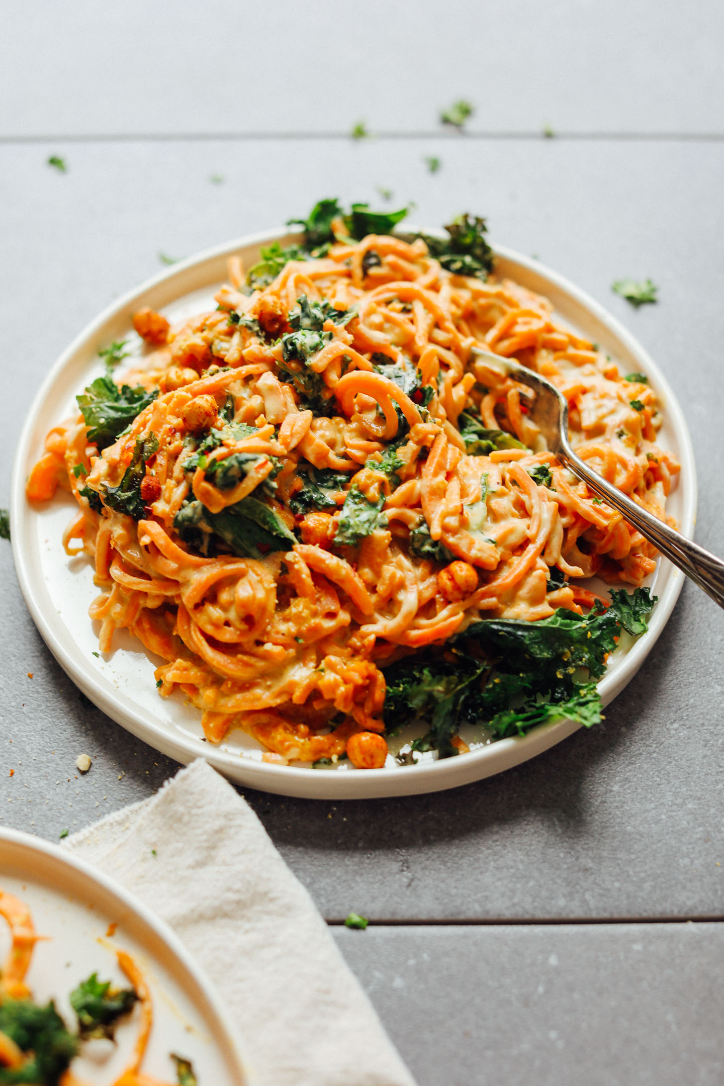 Close up shot of a plate of Garlicky Sweet Potato Pasta with Crispy Kale for a simple gluten-free vegan meal