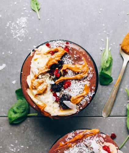 A big Peanut Butter & Jelly Acai Bowl for a plant-based breakfast