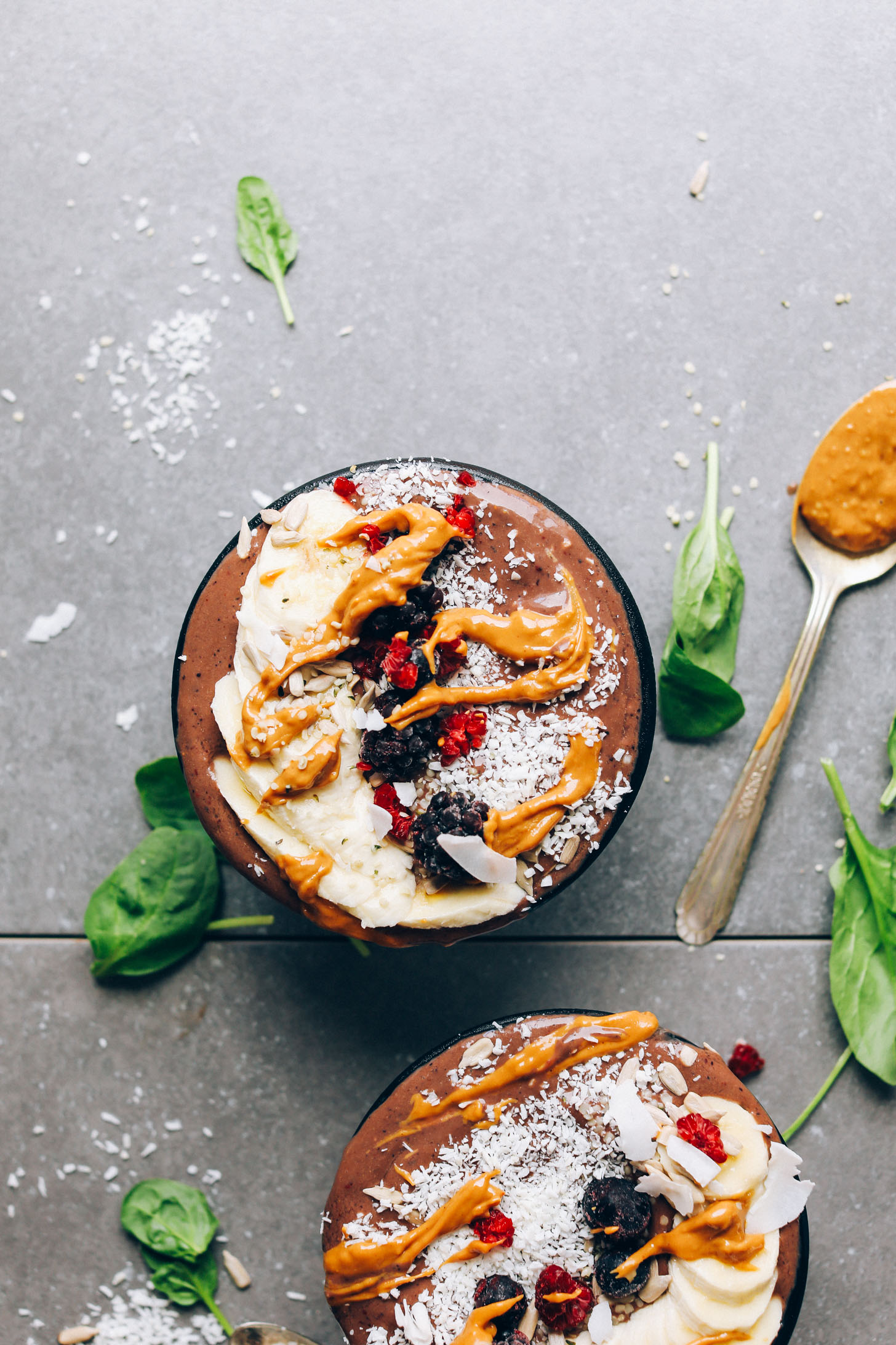 Peanut Butter and Jelly Acai Bowls topped with fresh fruits, peanut butter, and coconut