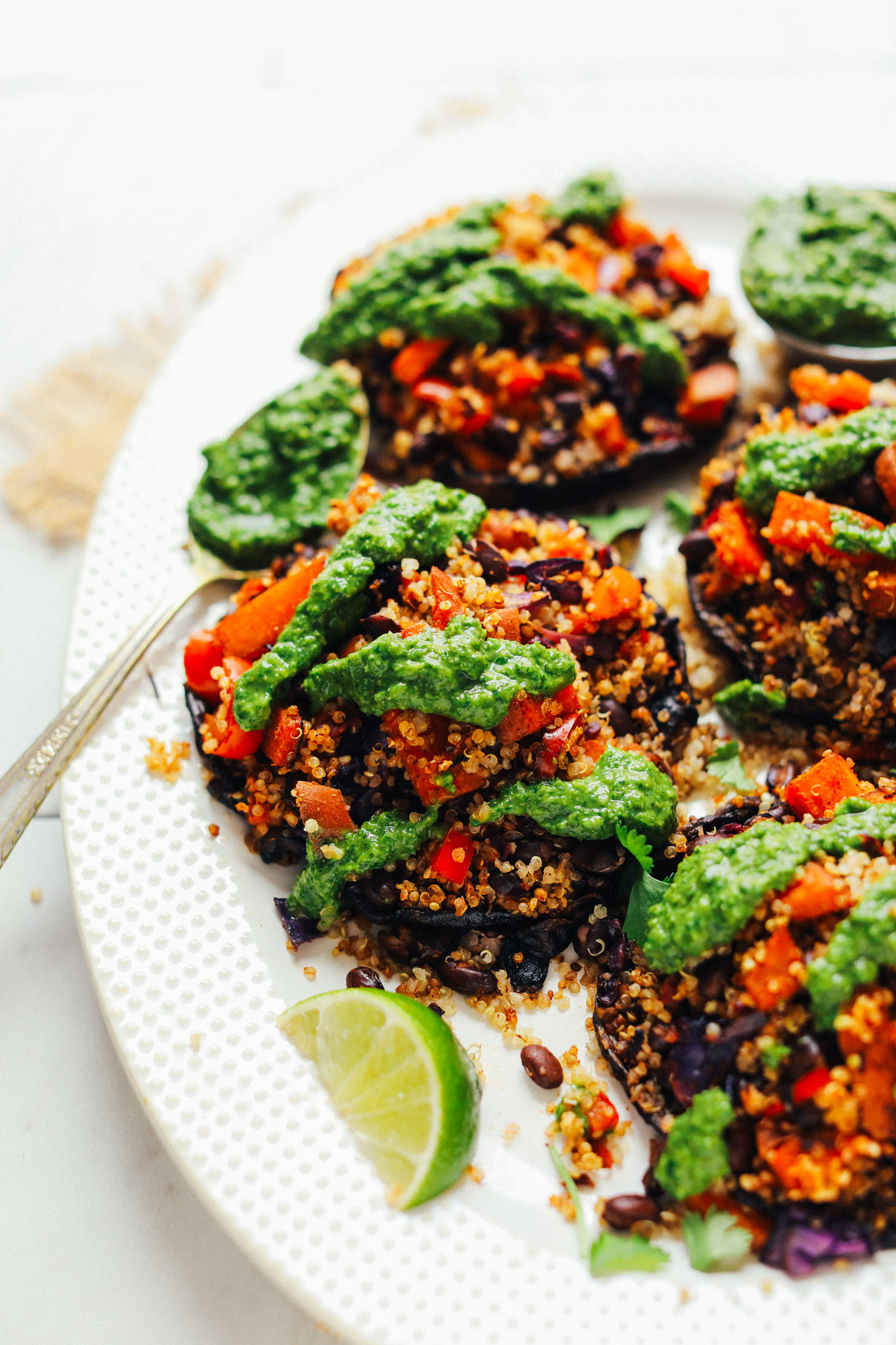 Serving platter with gluten-free vegan Vegetable Quinoa Stuffed Portobello Mushrooms