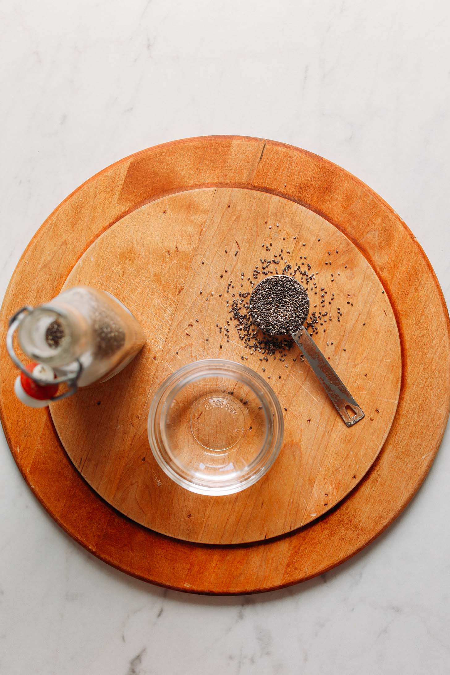 Chia seeds and water on a cutting board for making our chia egg recipe