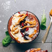 PBJ Açaí Bowl topped with sliced banana, berries, coconut, and nut butter
