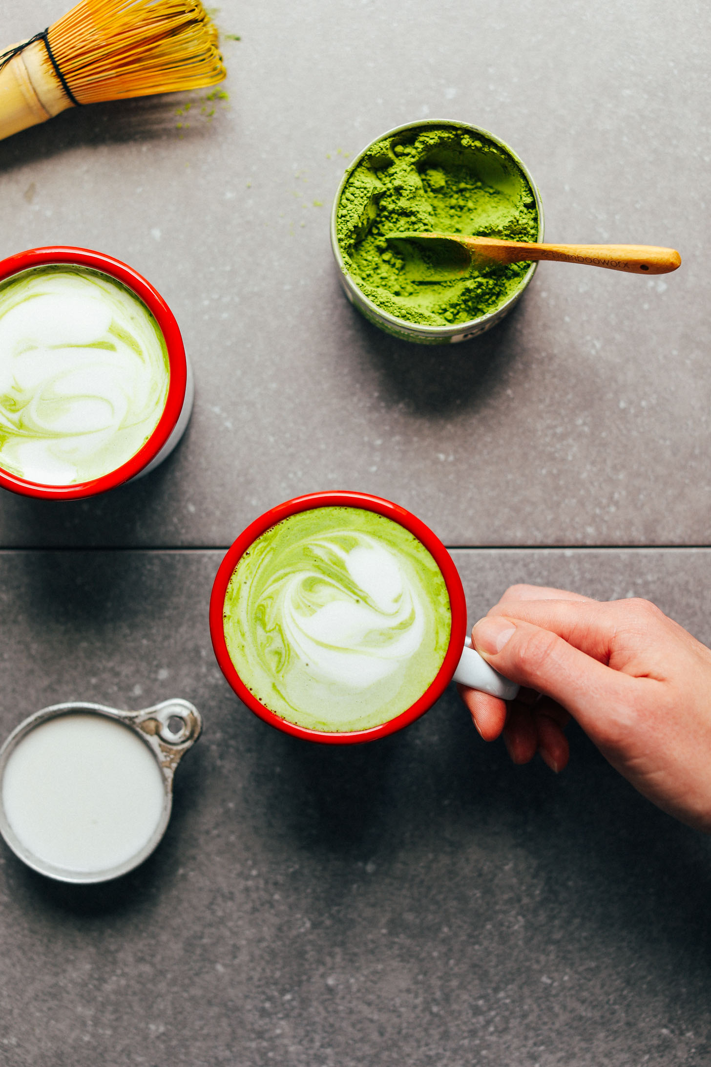 Grabbing a mug of the best matcha latte made with coconut and macadamia milks