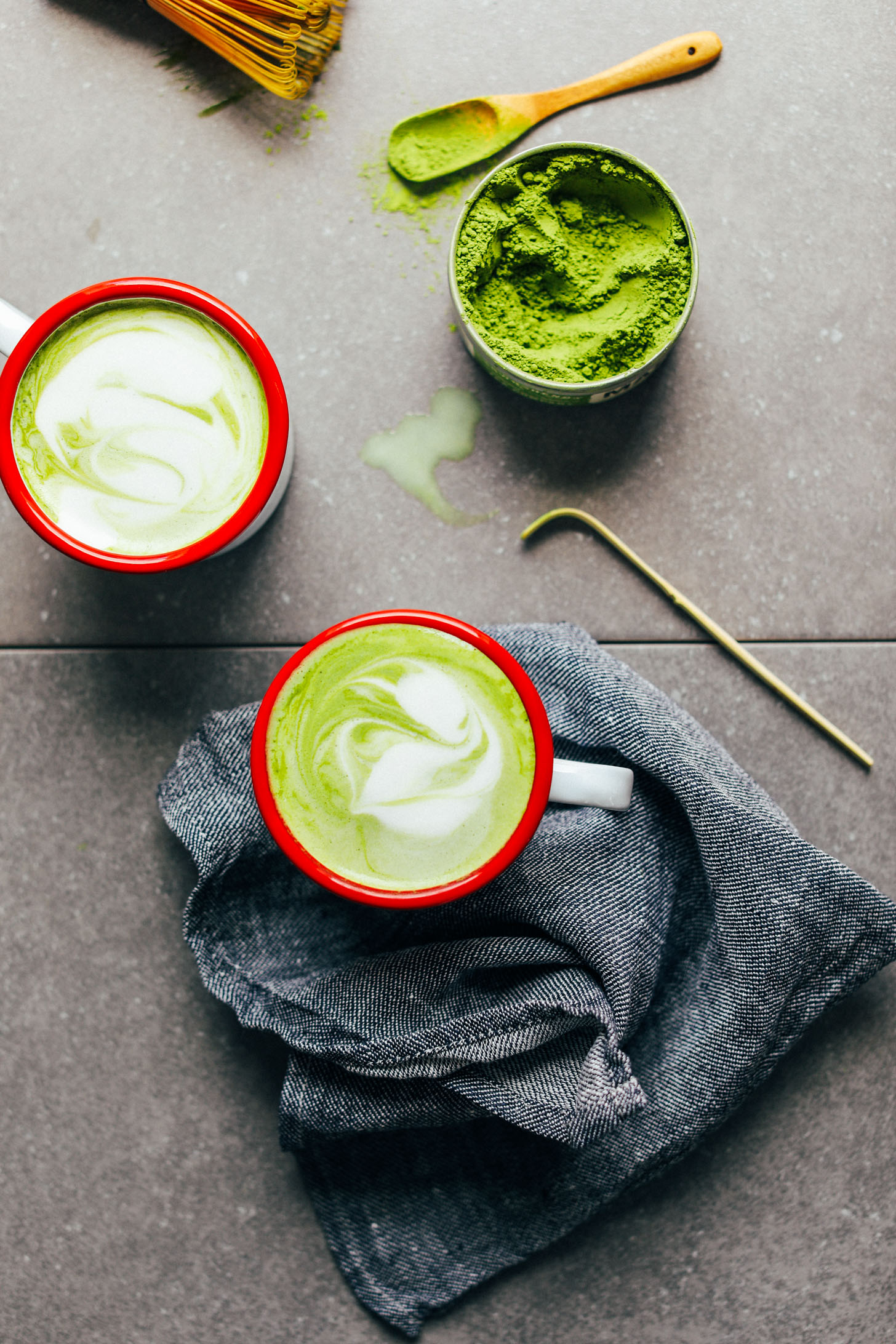 Two mugs of the best vegan Matcha Latte made from coconut and macadamia nut milks