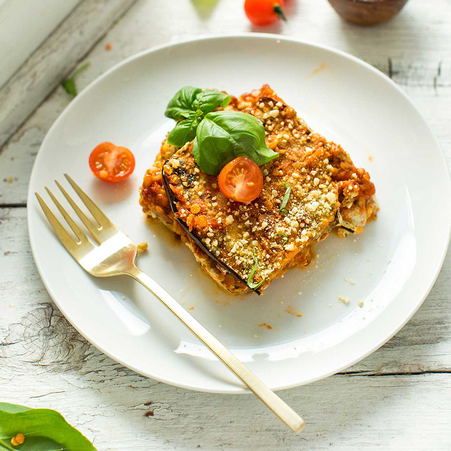 Slice of eggplant lasagna for our recipe roundup of 16 Vegan Entrees for Stress-Free Cooking