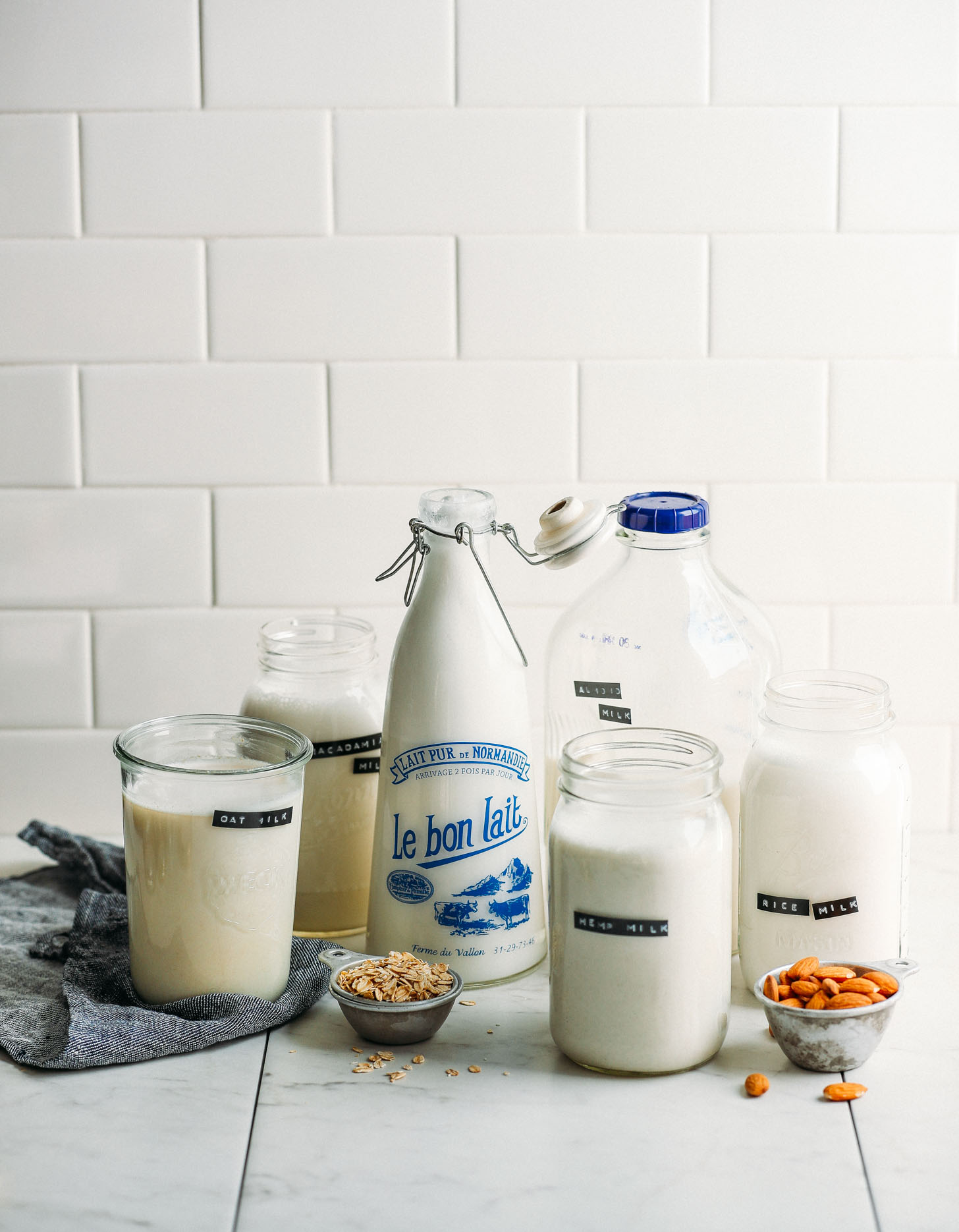 Jugs of DIY dairy-free milks including homemade rice milk