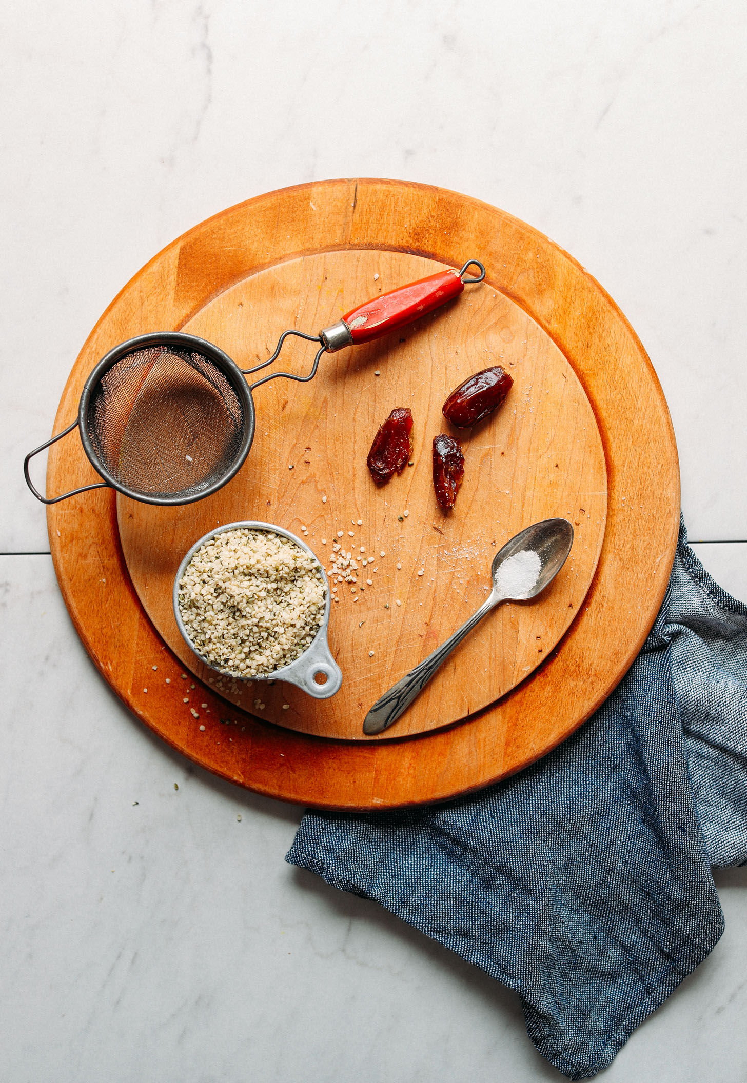 Wood cutting board with ingredients for making homemade Hemp Milk